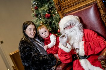 Santa with young mum and her baby attending the Family Nurse Partnership programme Christmas celebration event in the Guildhall, Londonderry.