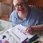 Service User completing their Learning Disability Week Activity Book at home