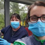Staff during an outreach bus journey