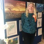 Aisling McCooey with her painting