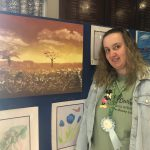 Carla Priestley with her painting